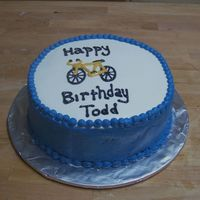 Bicycle Birthday Cake  I am giving credit to jlvmorales for the bicycle design. I coworker loves to bike so we put a bike on his cake. He loved it. White cake...
