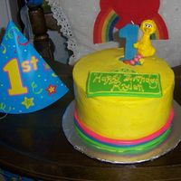 Sesame Street 1St  I did this cake for a child's 1st birthday. It was just the smash cake so it was a pretty small cake. Butter Cake with vanilla BC and...