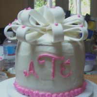 Monogram Cake  I made this cake for a friend who just had her first baby-a little girl. I love the way my bow turned out!! It's a spice cake with...
