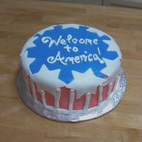 Welcome To America  A chocolate cake with raspberry filling. Whipped icing with fondant decorations. Made for a coworker who's uncle was visiting the U.S...
