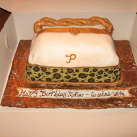 Purse Cake 1st purse cake for my mom. need more practice she thought it was a pillow!MMF.animal print icing sheet