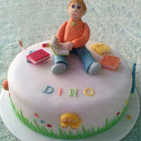 Dino`s Cake Back To School cake for my nephew Dino. Everything made out of fondant...Thanks for looking!