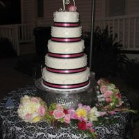 Amanda's Wedding Cake 5 tiered - Buttercream with pink and black ribbon . This was my very first wedding cake that I made for my daughter's wedding.
