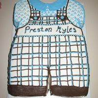 Baby Myles Sheet cake cut in the shape of romper. White cake with chocolate pastry cream filling and buttercream icing.