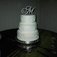 Ashlees_Wedding_Cake_001.jpg   White 3-tiered cake with a curly pattern. This was my first time haveing to freehand a design.