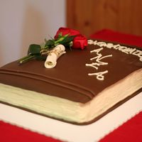 Graduation Book Cake French Vanilla Half Sheet Cake with Raspberry Filling. Covered in White Chocolate Cream Cheese Frosting and then decorated with MMF(the...