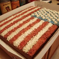 American Flag A full sheet(2 11x17 cakes put together) chocolate cake with Chocolate buttercream frosting. The red, white and blue crumbles are White...