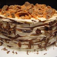 Butterfinger Cake Peanut Butter cake, Chocolate/chunky peanut butter filling, covered with White chocolate cream cheese frosting, and decorated with...