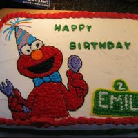 Elmo Cake I did this for my daughter's 2nd birthday. It is my first attempt at a transfer. It's not perfect but I was pleased with it.
