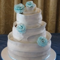 White Wrap Chocolate sponge cake wrapped with chocolate paste. Dusted with silver luster dust. Chocolate paste roses