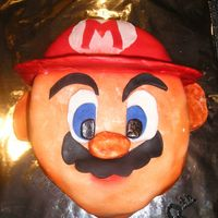 Mario.jpg  Thanks you to msauer for her step by step photo and instructions. My cake was changed a bit in size and my Mario looks a bit sun burnt. I&#...