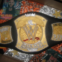 Wwf Wrestling Belt  I baked a carved a 1/2 sheet cake for this. The client supplied a toy belt for sizing. As it turned out the 1/2 sheet was a little short so...