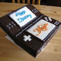 "Nintendo Ds Chocolate ganache with white chocolate decorations. DH built the wood stand helping the ""top cover"" bend."