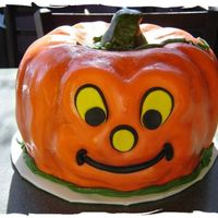 Happy Jack-O-Lantern Fondant Covered and painted pumpkin. Two bundt pans put together formed this happy pumpkin!