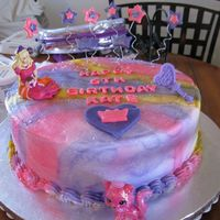 Barbie And The Diamond Castle the little girl wanted pink and purple and a tiny bit of yellow. The barbie and mirror are cake toppers she also wanted on it.