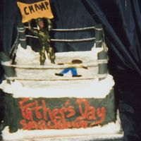 "Fathers Day Smackdown This is my DH fathers day cake all is edible except the yarn I used as ropes and my ""DH"" the champ. I covered pretzel rods with..."