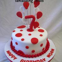 Red And White Cake made for a red themed birthday party. bubble gum balls around the base of the cake. everything else is fondant.