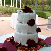 White Cake W/red Roses The bride I worked with saw a very similar design on Cake Central, with the cascading bow. It is a white cake with strawberry filling,...