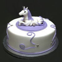 "Unicorn Birthday Cake for an adult who loves unicorns. 10"" cake, topper is fondant."