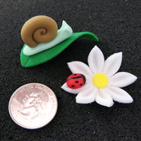 Daisies And Snails Cupcake toppers for my son's class party. Snails for the boys and flowers for the girls. They were a big hit! (Quarter for size...