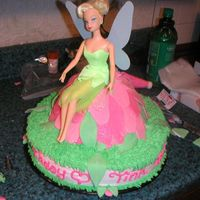 Tinkerbell Tinkerbell cake, I used the wonder mold to create the flower mound. The petals are made from fondant. the rest is buttercream.