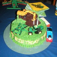 John Deer Cake This cake was made for my 3 year old nephew, He refused to let anyone cut it.