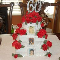60Th Birthday This is a 60th Birthday cake for a friend. The pictures are edible. The roses are fondant. I was having a hard time with the gumpaste this...
