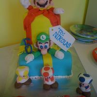 Mario And Luigi Birthday Cake This is a cake for my neighbor's son that loves Mario and Luigi and was very specific on what he wanted on his cake:) Everything is...