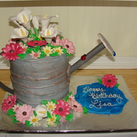 Lisa's Watering Can White velvet cake torted and filled with dark chocolate ganache.