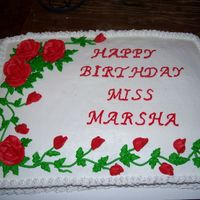 Red Rose Cake white cake with buttercream frosting