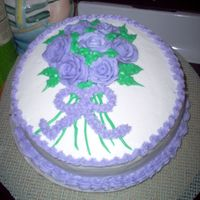 Practice Cake practice cake. I can not do the bow. I keep drooping the edges of the bow. So I just made it out of stars.
