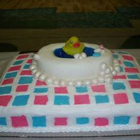 Ducky Tub Cake bathtub is a pound cake hollowed out. Tile, bathtub, bubbles, facuets are all mashmallow fondant. Water is berry blue jello