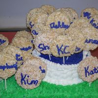 Basket Full Of Goodies basket weave basket filled with rice krispy treated lollipops setting in a grass. All buttercream. Handles are marshmallow fondant