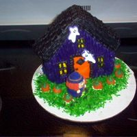 Stand Up House Cake triple chocolate cake with buttercream frosting. The witch is marshmellow decorated with royal frosting and sprinkles. I found them in a...