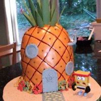 Spongebob's House This was for my son's birthday. 9 in rounds stacked with wonder mold on top and then sculpted. Covered in fondant and dusted/painted....