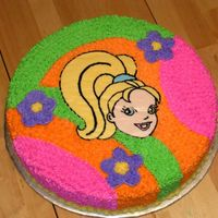 Polly Pocket 12 inch round. Frozen buttercream transfer of Polly's Face. Tip 16 stars for the rest of the cake. The flowers are a little raised...