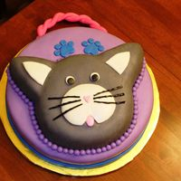 Kitty Cat Purse Cat was made using the Animal Crackers pan from Wilton. The base was a 14 in round. Handle was made with gumpaste, cake covered in...