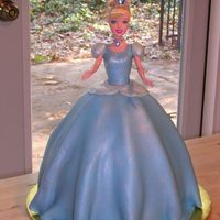 Cinderella Used wonder mold and extra 9 in. round at the bottom. Real Cinderella doll. Covered in MMF. Top of the dress has cake sparkles, and skirt...