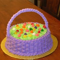 Easter Basket Handle is made of royal icing. Basketweave in buttercream. Grass is coconut, and eggs are jelly beans.