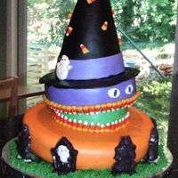 3 Halloween Vignettes Topsy-turvy cake with 3 vignettes: a cemetery at the bottom with chocolate tombstones, a witch's hat on the top (made with Rice...