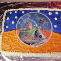 Buzz Lightyear Edible Image Cake I got the idea from a few posters here and used the orange and blue icing to make it look like there was no image. It was my first time...
