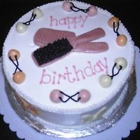 Barrette Cake   this cake was for a 3yr old girl who carried around combs, brushes and barrettes. the barrettes, comb and brush are made of starbursts.