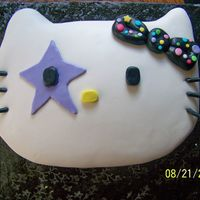 Hello Kitty Rock N Roll  this turned out to be a huge Hello Kitty head! I forgot my other one was only 1 layer/ 1/2 sheet of cake! Soo I had to layers ( 2 Half...