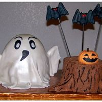 Ghost And Stump Two seperate cakes for a Halloween Birthday. Ghost is Red Velvet covered in fondant. Stump is german chocolate cake with coconut filling...