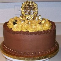 50Th Anniversay Chocolate 50th Anniversary Cake, chocolate cake, chocolate kahlua mousse filling. Gold buttercream roses topped the cake and were dusted in gold...