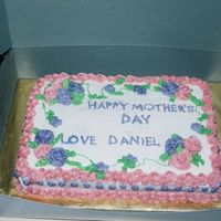 Mother's Day Cake   1/2 sheet iced in buttercream and decorated with simple roses