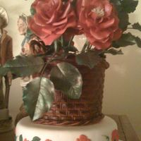 Basket Of Roses gumpaste basket and gumpaste roses on a small dummy cake.