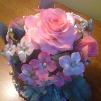 Crown And Flowers this is the back view of a silver crown filled with flowers I did for a friend to use as a topper for her 6 year old daughter's...