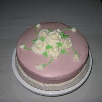 Final Cake Course I Pineapple cake with Mauve Buttercream frosting. I had a hard time with the roses as the temp in the room was 92 degress. The air was broken...