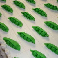 Pea Pod Sheet Cake   I made two 1/2 sheet cakes for a seed company party. Each scored piece had a fondant pea. They loved it.